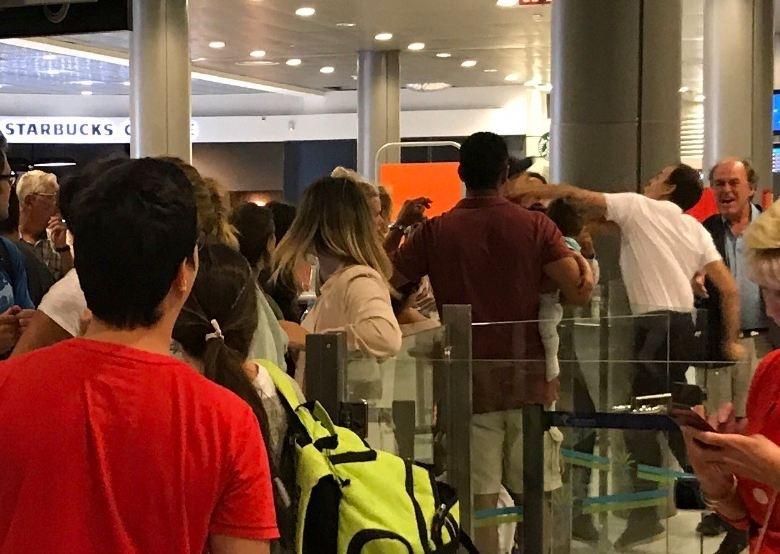 Airport staff punching easyJet passenger