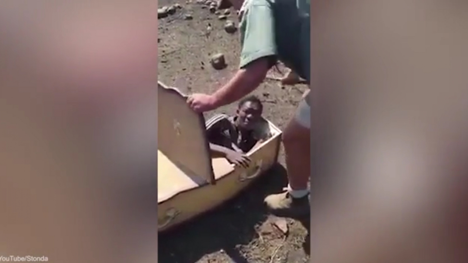 Disturbing video shows two white farmers forcing a black man into a coffin