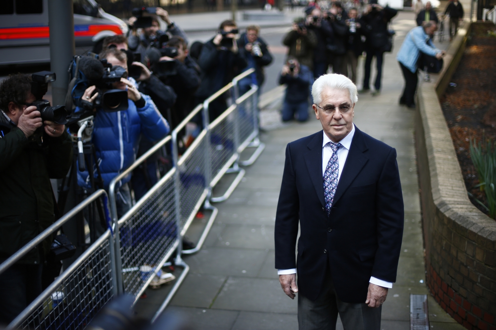 Publicist Max Clifford arrives at Southwark Crown Court in central London March 5, 2014
