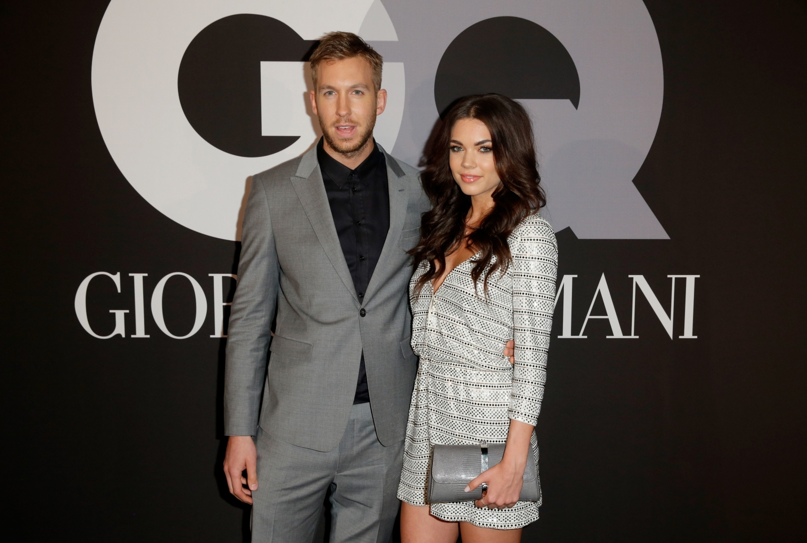 Calvin Harris (L) and model Aarika Wolf