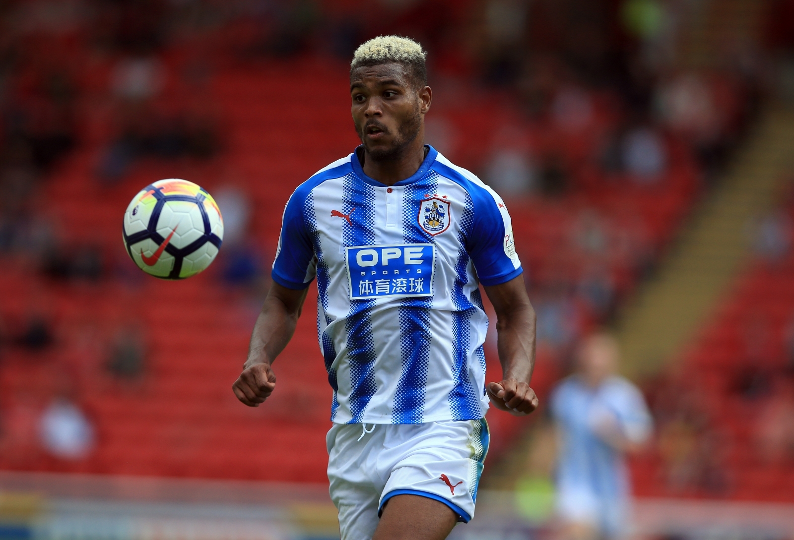 Two-goal Mounie helps Huddersfield to shock win at Palace