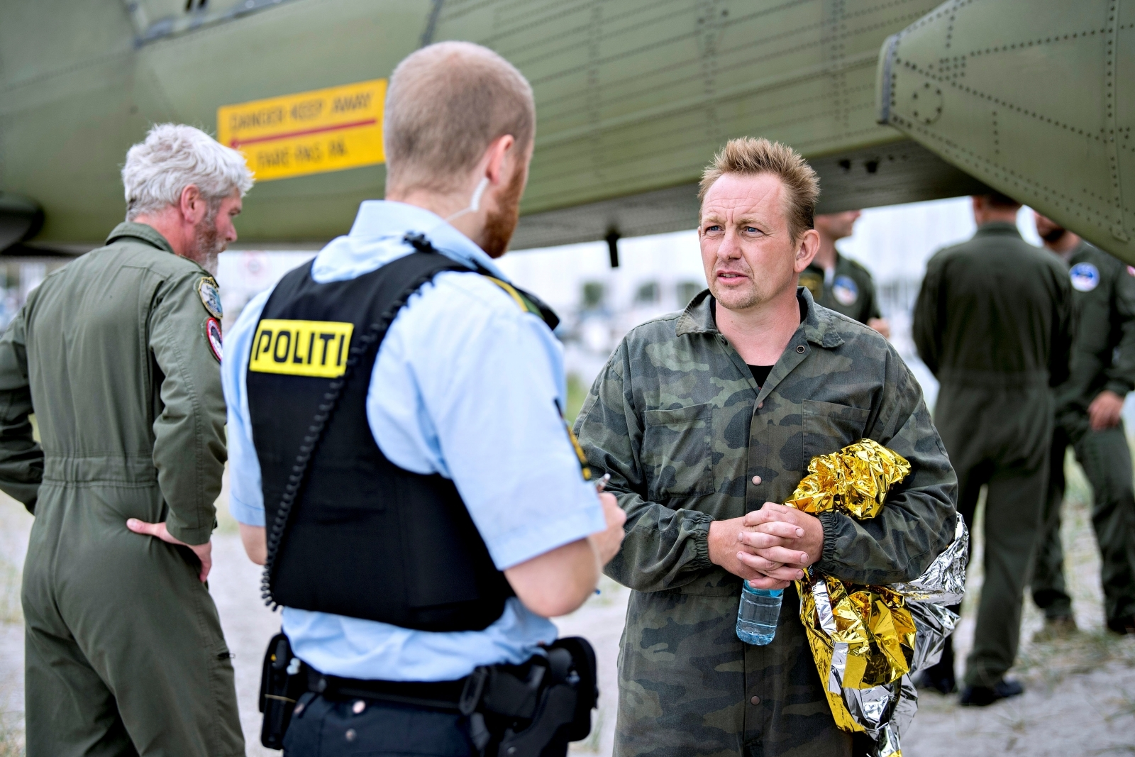 Danish submarine owner and inventor Peter Madsen talks to Danish police in Dragor Harbor south of Copenhagen, Denmark