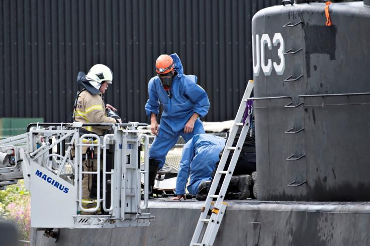 Police investigate the rescued private submarine