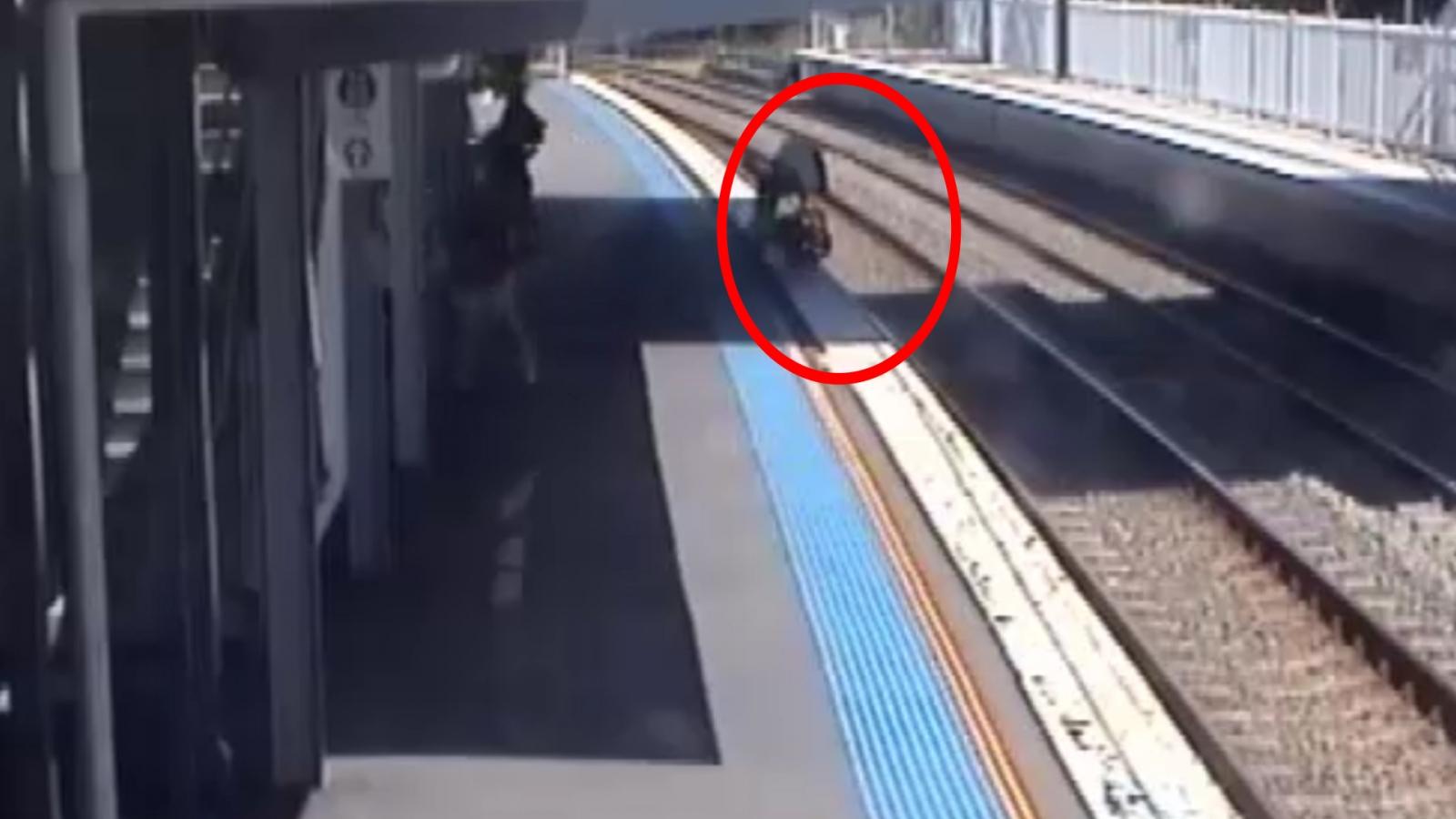 Mum Desperately Rescues Baby as Pram Rolls on to Train Tracks