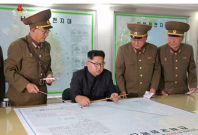 North Korea: Kim Jong-un 'Briefed' On Plan To Fire Missiles Near Guam