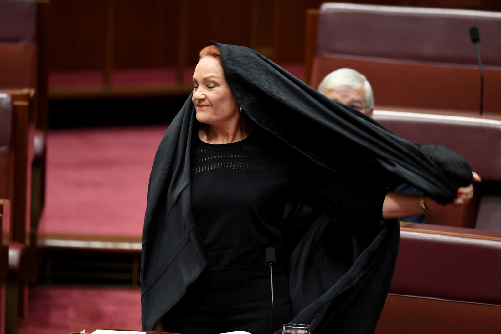 Right-wing Australian senator wears burqa in parliament and calls for the garment to be banned
