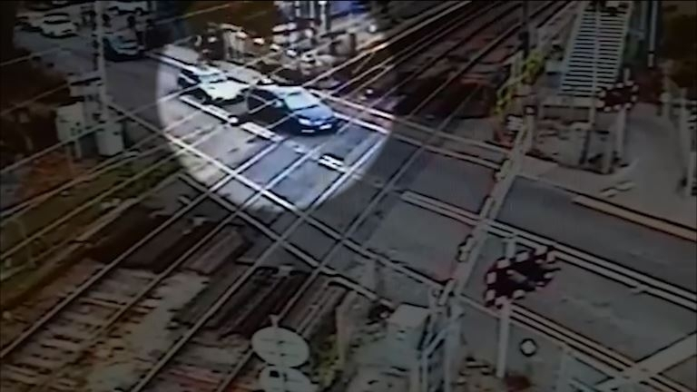 Watch panicky learner driver make destructive mistake at level crossing in Essex