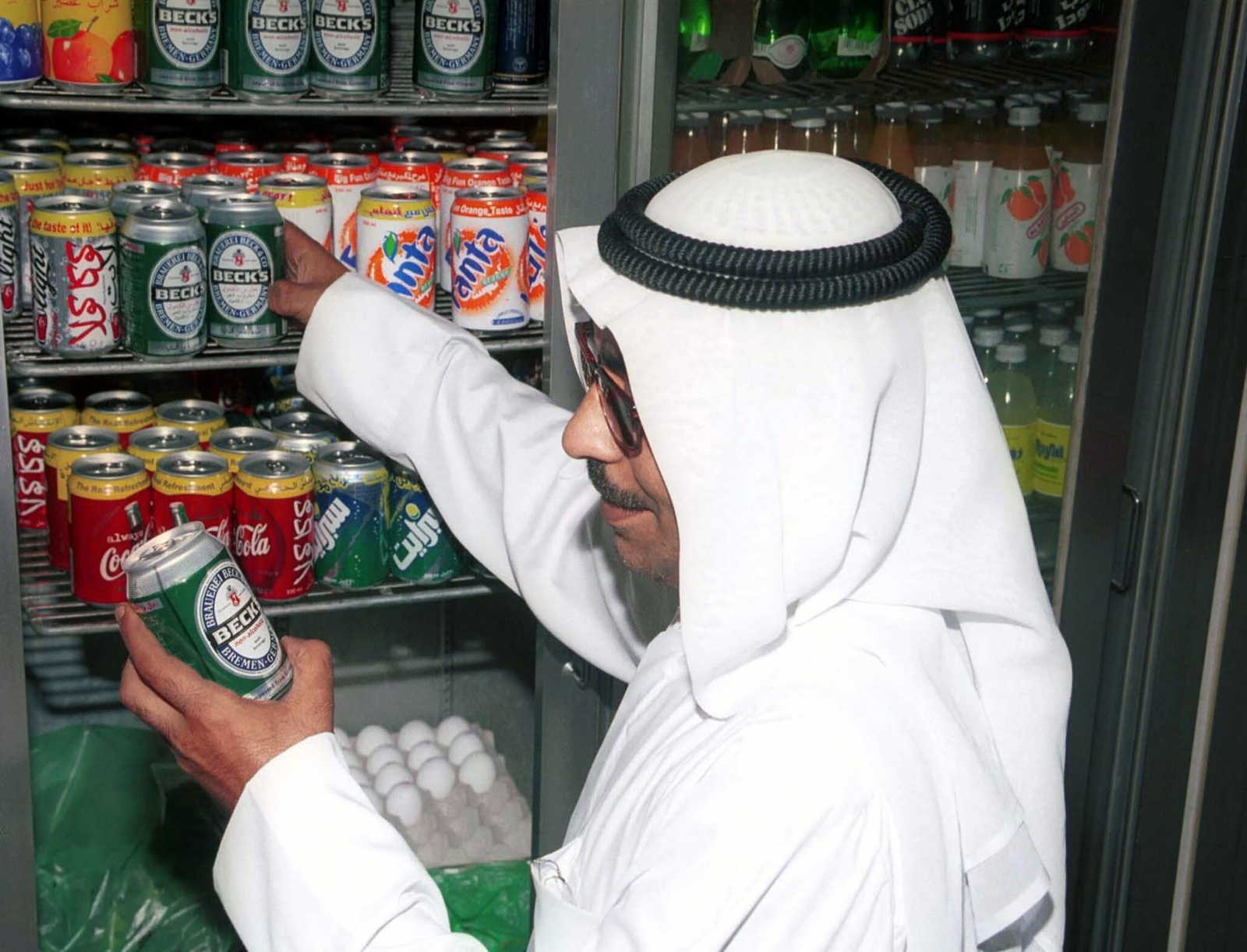 A Kuwaiti citizen Abu Yousif buys a can of non-alcoholic beer from a small grocery