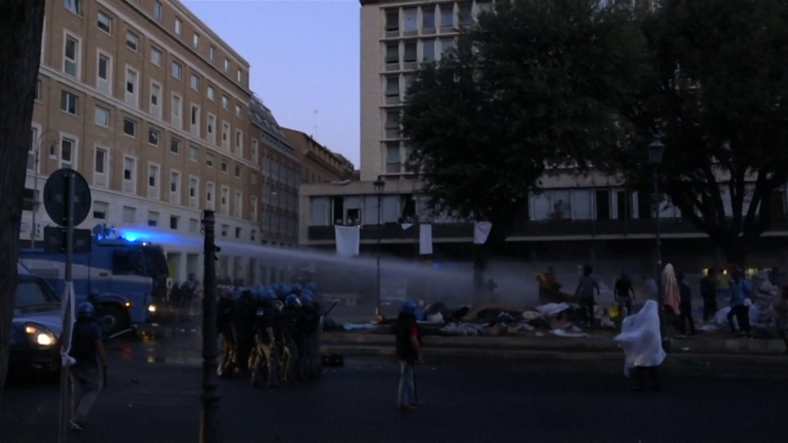 Police Use Water Cannons On Refugees In Rome