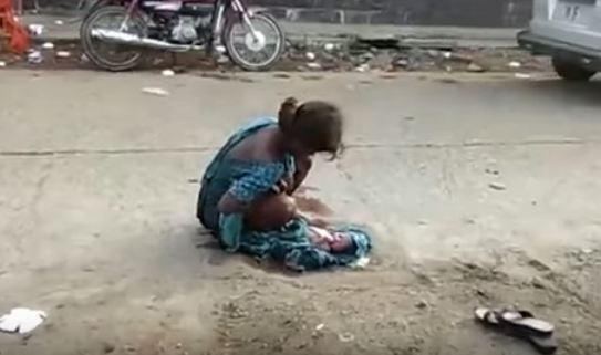 girl forced to give birth on street
