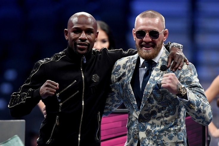 Mayweather and McGregor after the fight
