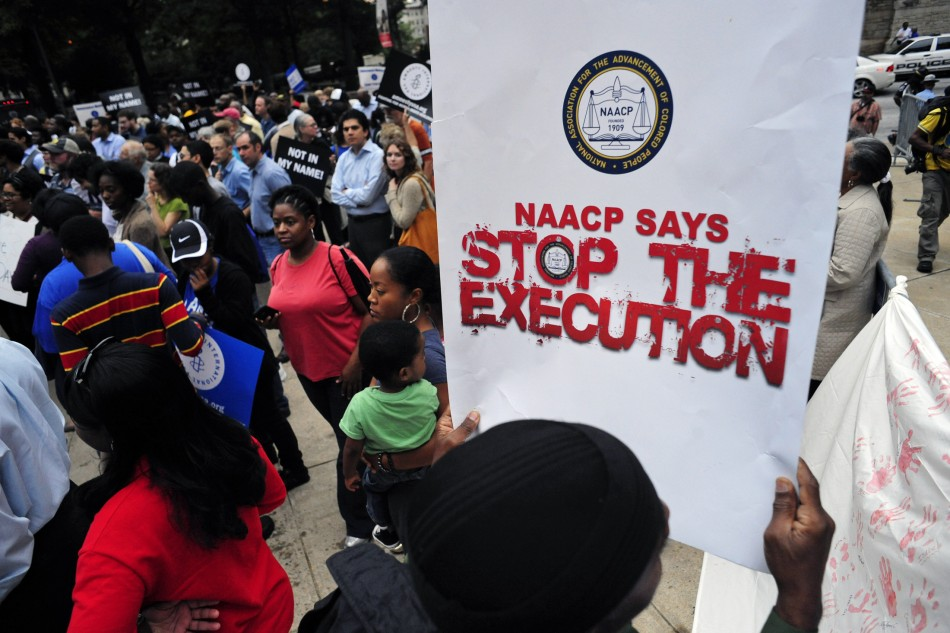 Protesters show their support for death row inmate Troy Davis during a rally at the capitol in Atlanta; over 1000 people attended his funeral today.