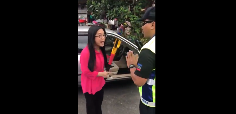 woman threatening council officer with a steering lock