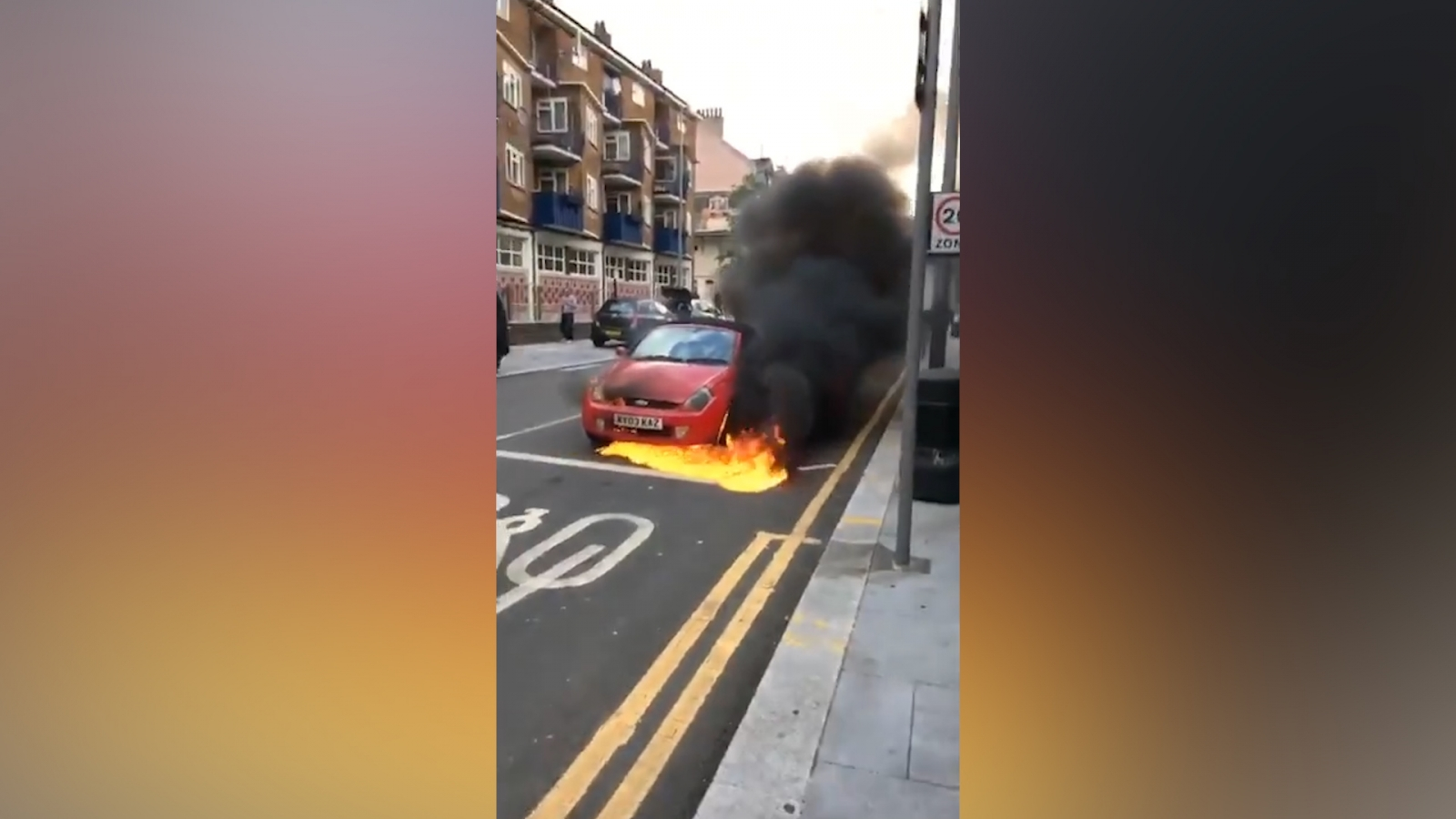 bystanders-attempt-to-stop-rolling-flaming-car-in-london