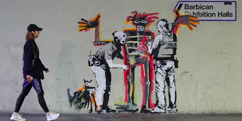 One of two new murals by street artist Banksy that that mark the opening of an exhibition by American artist Jean-Michel Basquiat in central London
