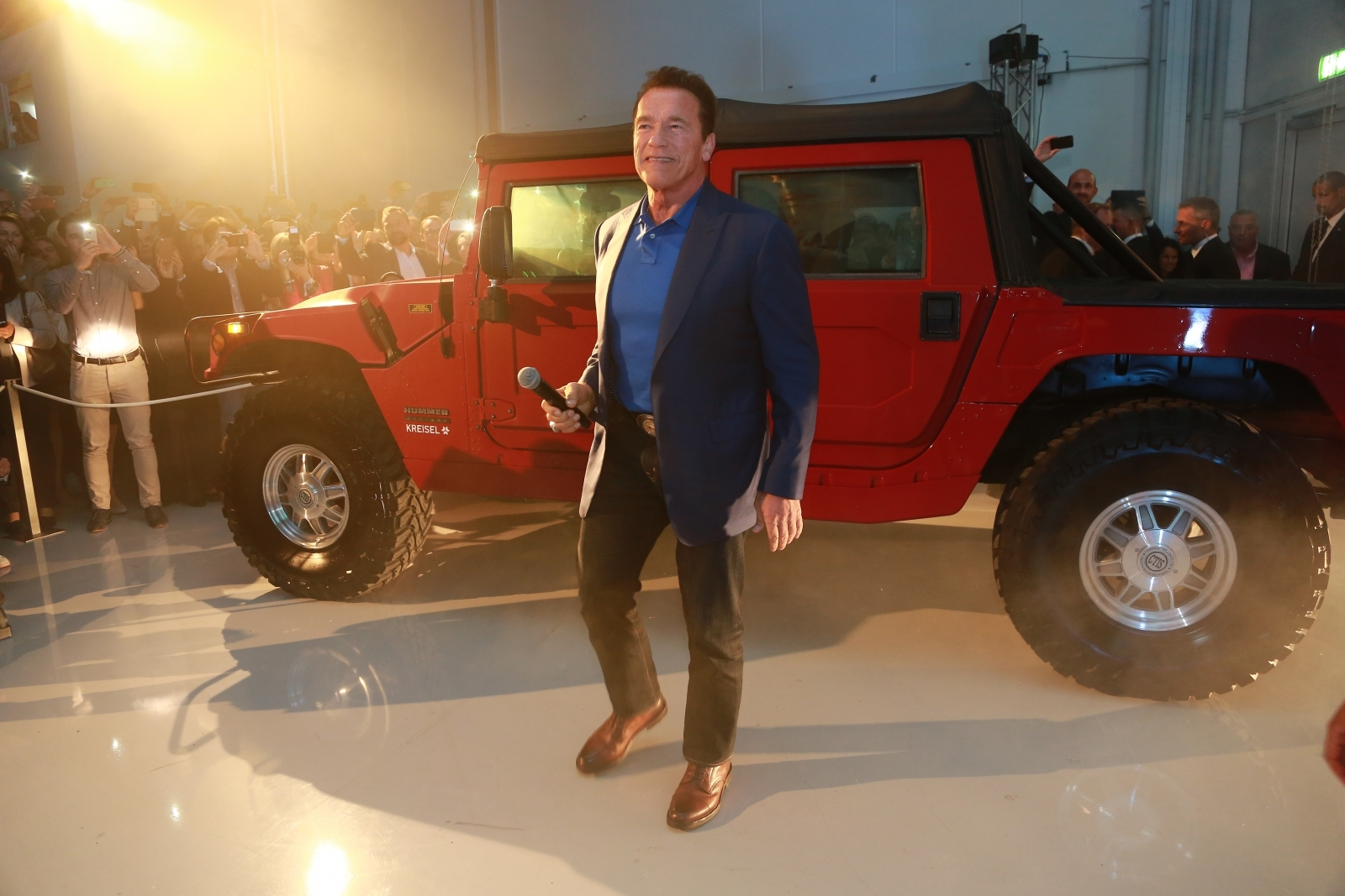 Arnold Schwarzenegger with electric Hummer