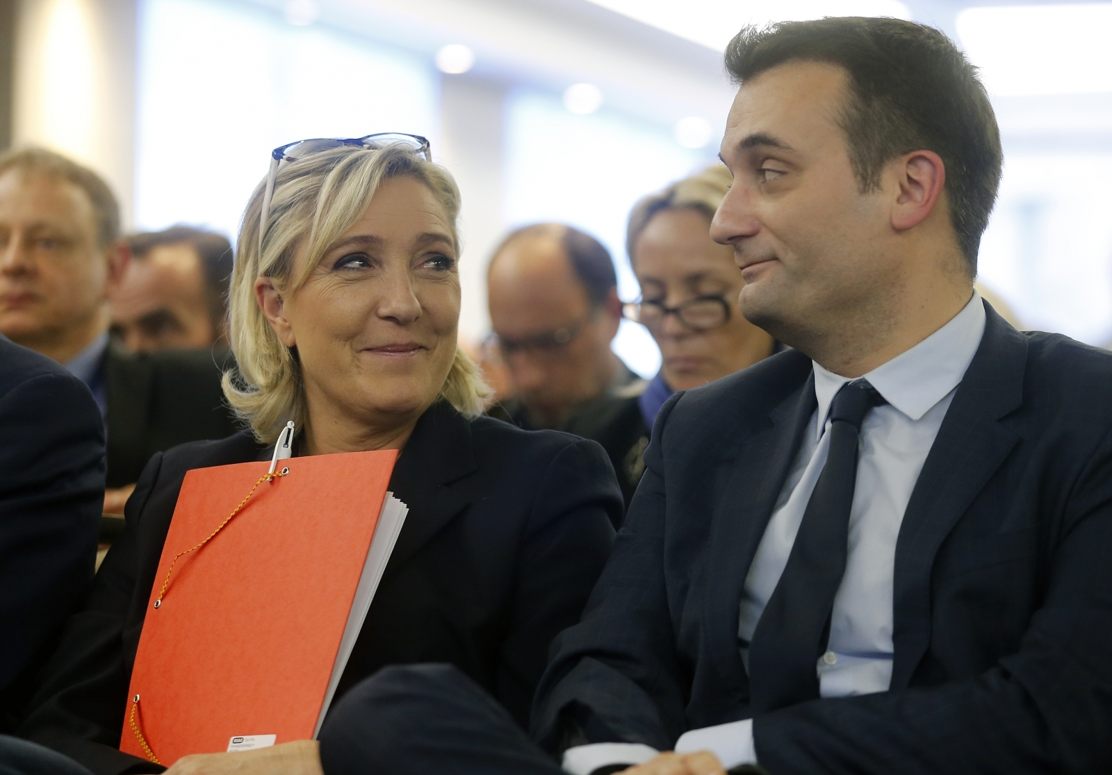 National Front leader Marine Le Pen (l) and her former right-hand man Florian Philippot at a conference last year (2016)