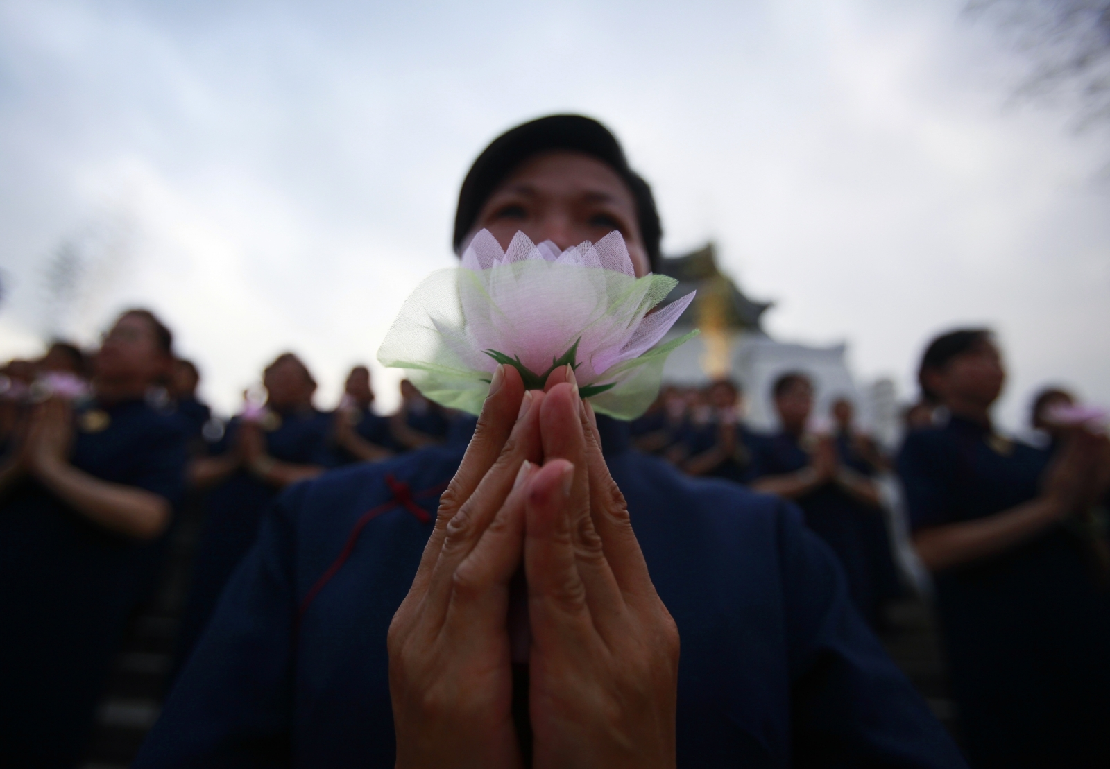 Buddhists pray during a ceremony to commemorate the birth of Buddha, at the Chiang Kai-shek Memorial Hall in Taipei May 8, 2011.