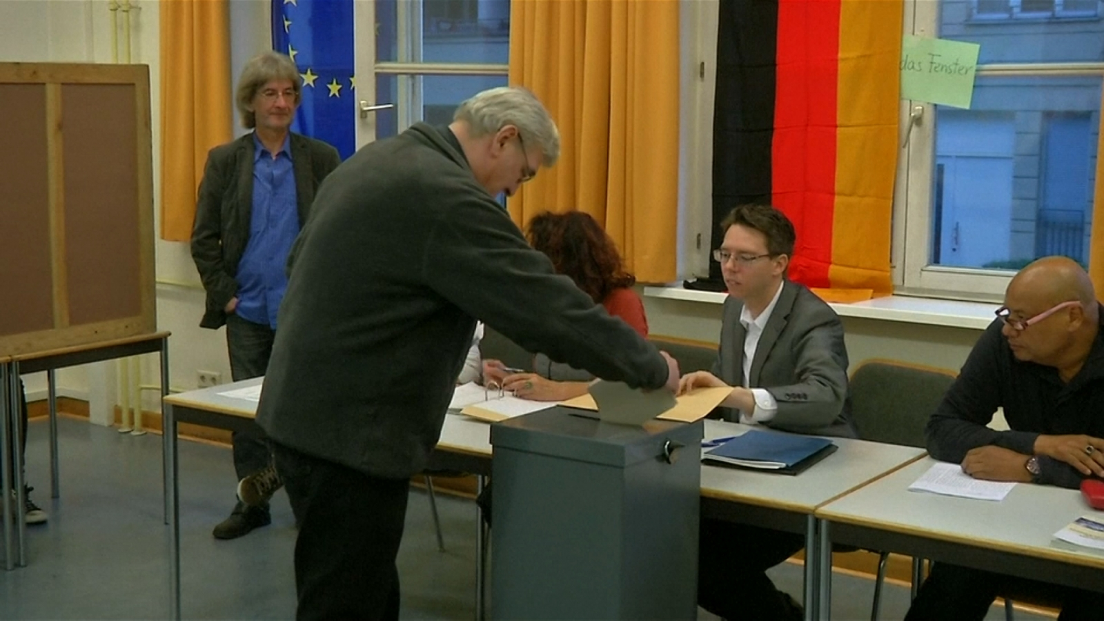 Germany starts voting as history beckons for Merkel