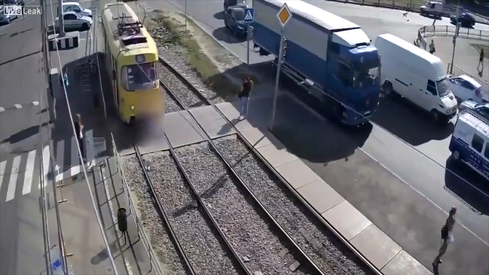 Woman distracted by phone loses leg after being hit by tram