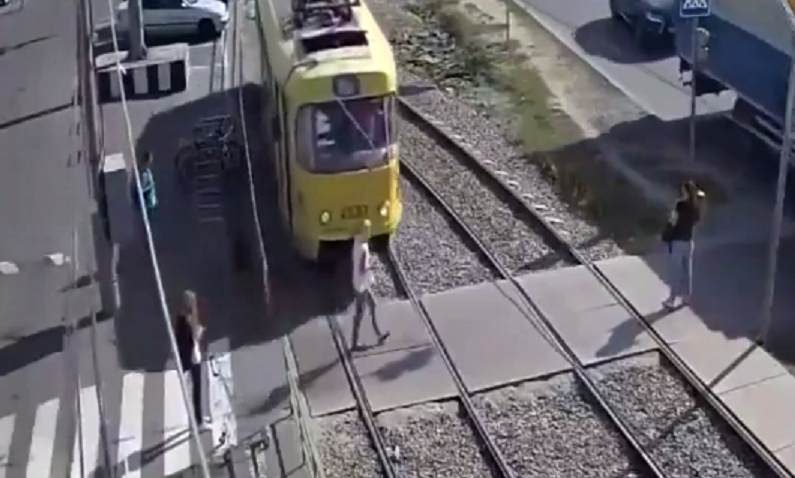 Enlightone: Horrifying CCTV Shows Tram Smash Into Woman Distracted By