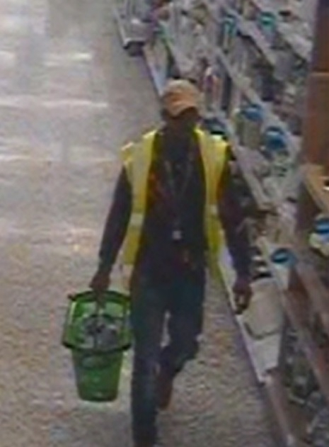 CCTV image of man wanted in connection with kidnapping a police officer outside an Aada supermarket in Ashton-under-Lyne
