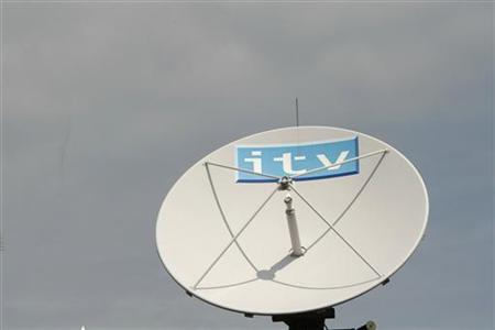An ITV satellite dish sits on top of the broadcaster's building in London