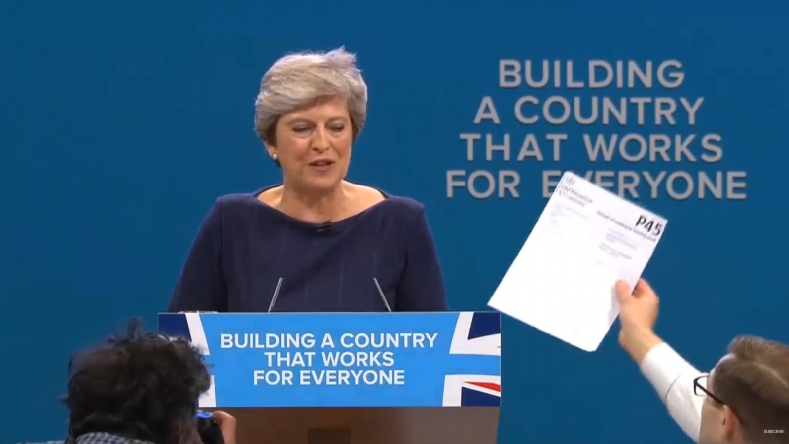 Watch Theresa May Be Given Her P45 By Protester At Conservative Party Conference