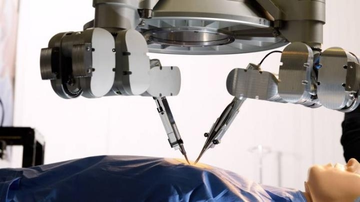 Robot conducts microsurgery