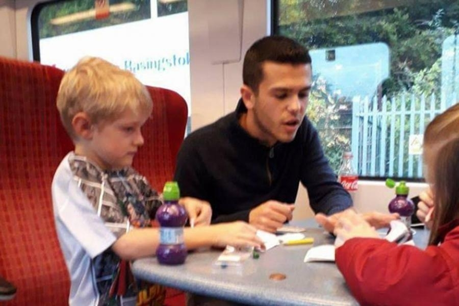 Daniel Ball lends a hand by plays with Jack, who has autism, and his sister Amy in an image posted by his mother Gayna Pealling