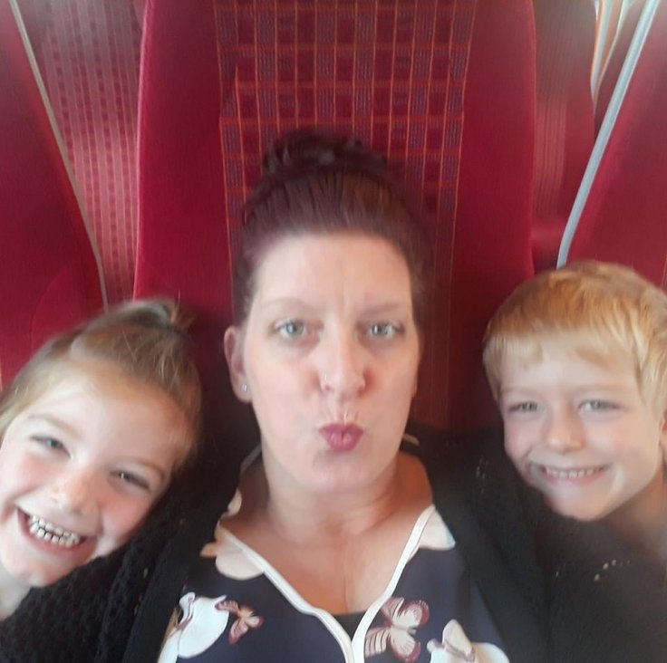 Gayna Pealling and her children, Jack and Amy, enjoy their train journey, which saw them helped by passing stranger Daniel Ball