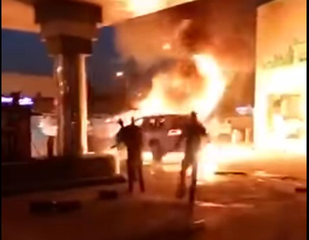 Man drives car into burning vehicle