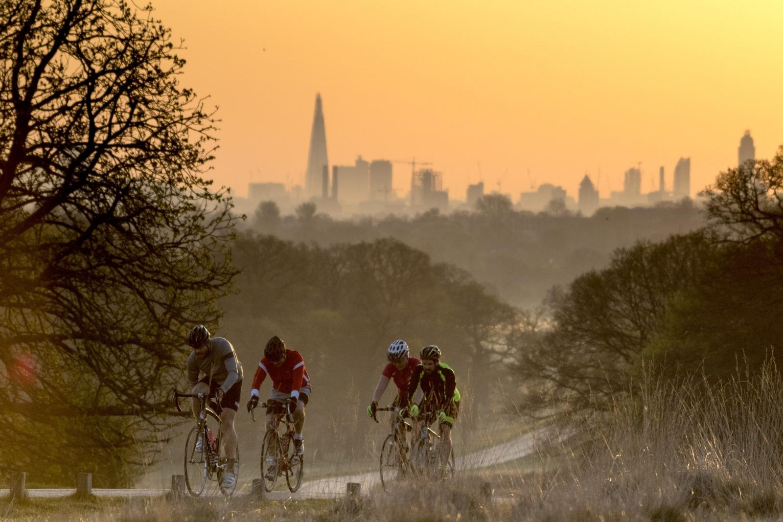 Cyclists make their way through Richmond Park