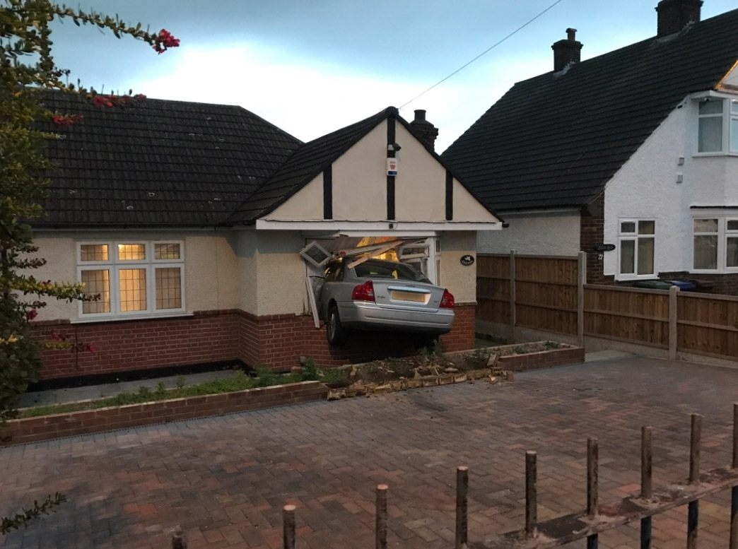 Man drove car into own home