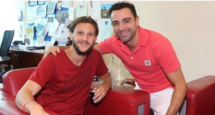 Adam Lallana and Xavi