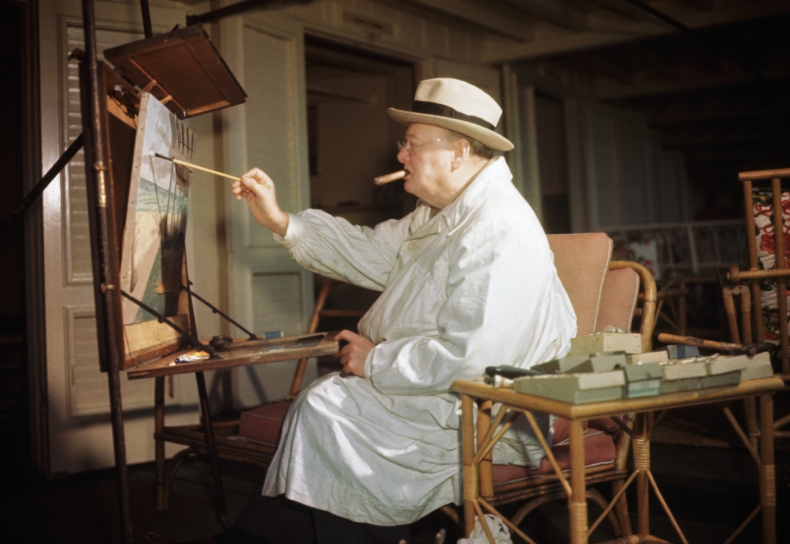 Winston Churchill engrossed in his hobby of oil painting at Miami Beach
