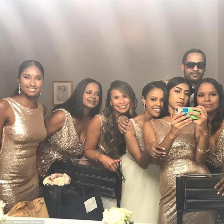 The bridal party relax at the reception at Foxchase Manor in Manassas, Virginia, with Austin fourth from left and Makonnen second from right