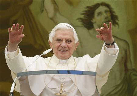 Pope Benedict XVI waves as he leads his Angelus prayer from the balcony of his summer residence in Castelgandolfo, south of Rome