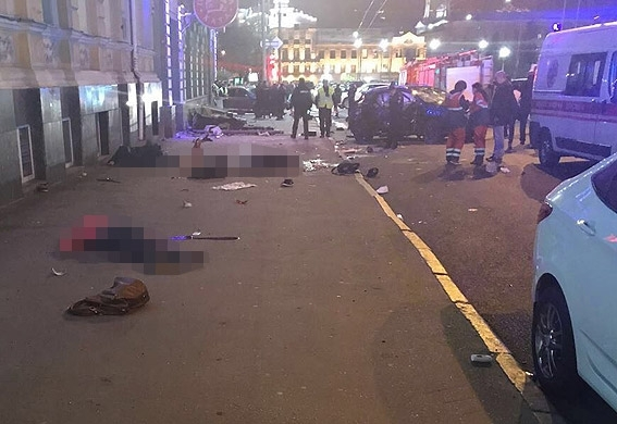 A number of bodies lie on the streets of Kharkiv after the crash involving a Lexus and a VW Touareg