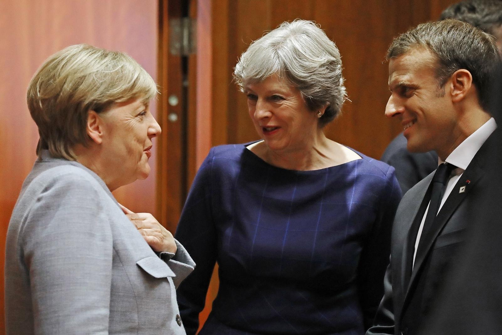 Angela Merkel, Theresa May and Emmanuel Macron