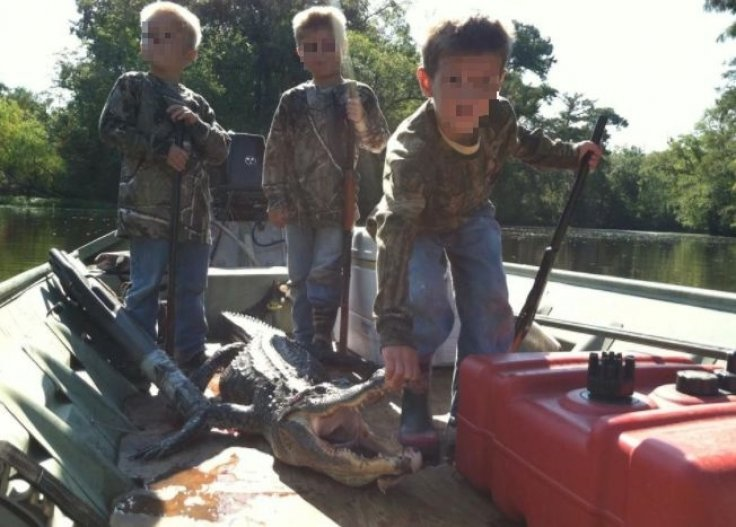 Kids dead alligator hunting