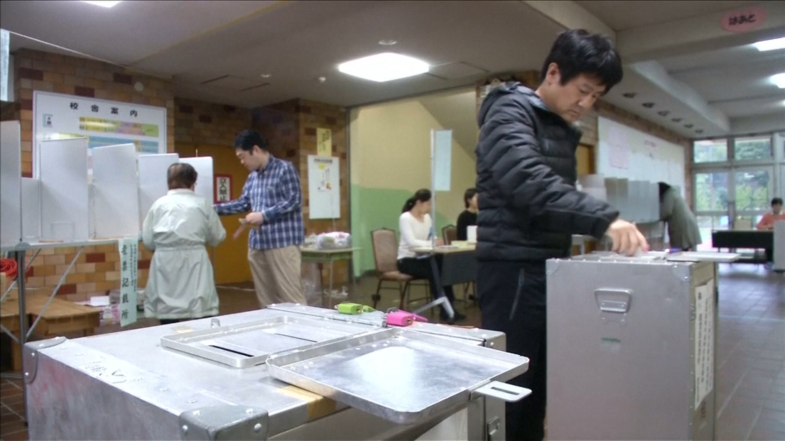 Japanese Voters Head To The Polls As Typhoon Lan Batters Country