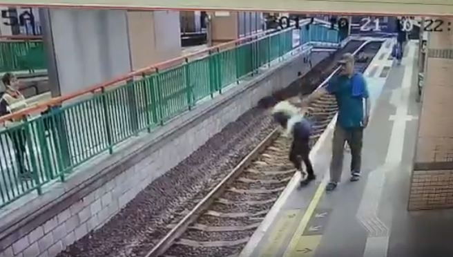 Man pushes woman on rail tracks HongKong