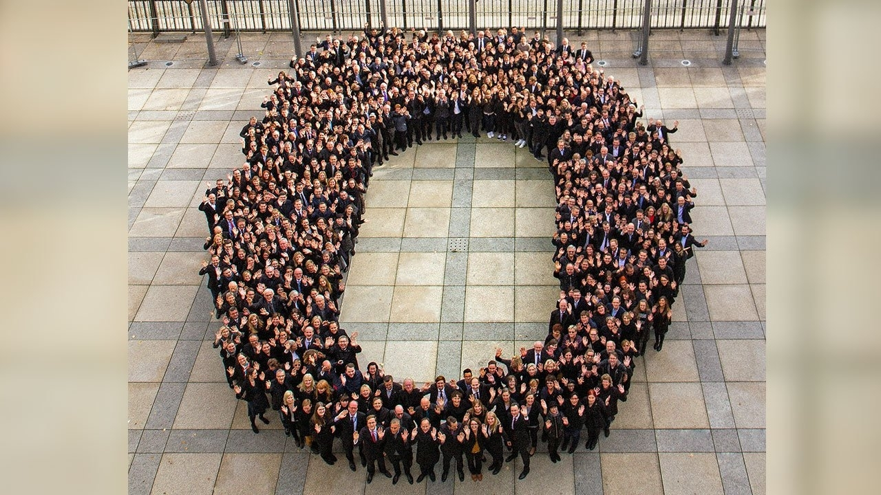 Hundreds of German finance ministry staff form a zero to celebrate the balanced budgets delivered by German finance minister Wolfgang Schäuble as he leaves office