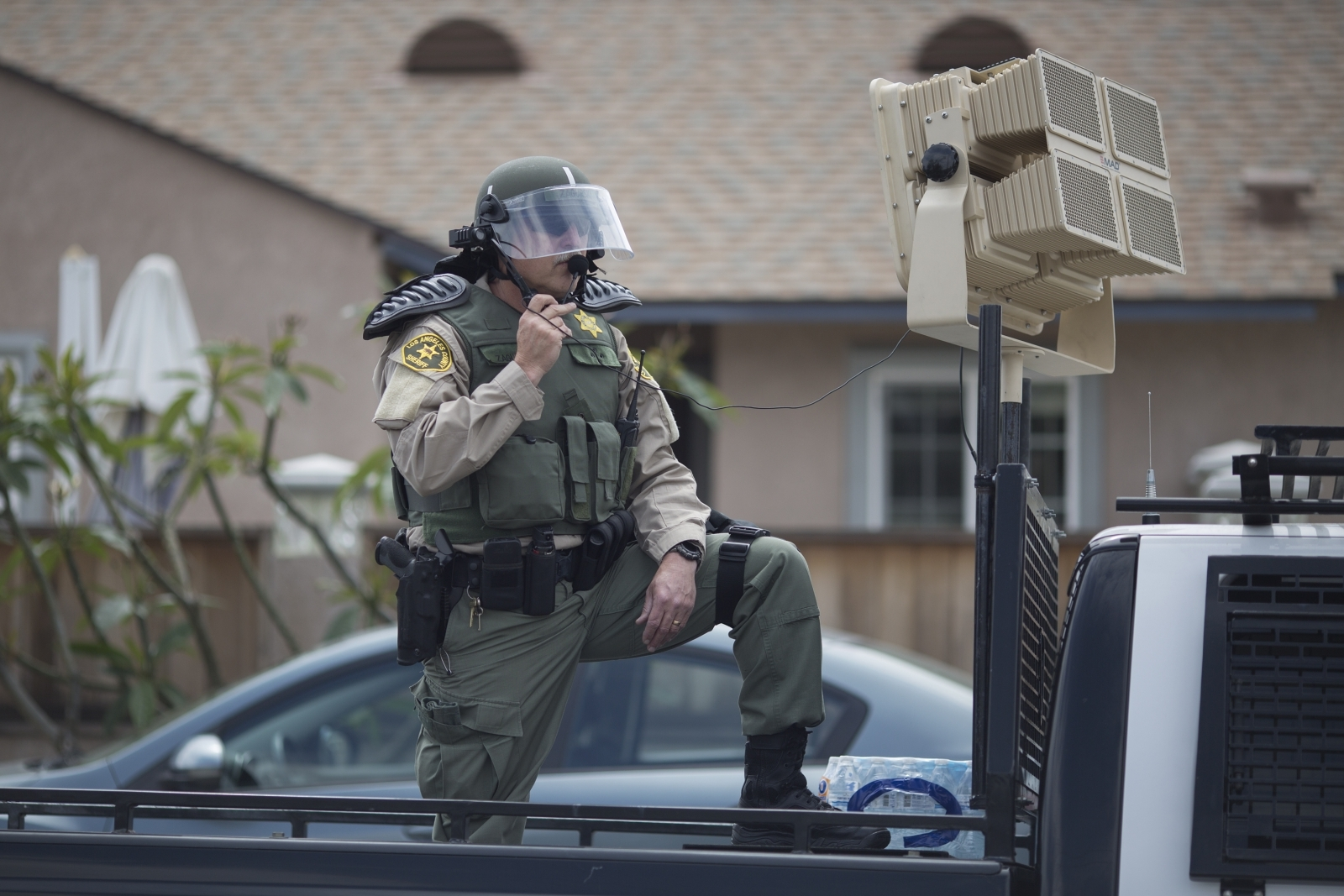 US police officer using sound weapon