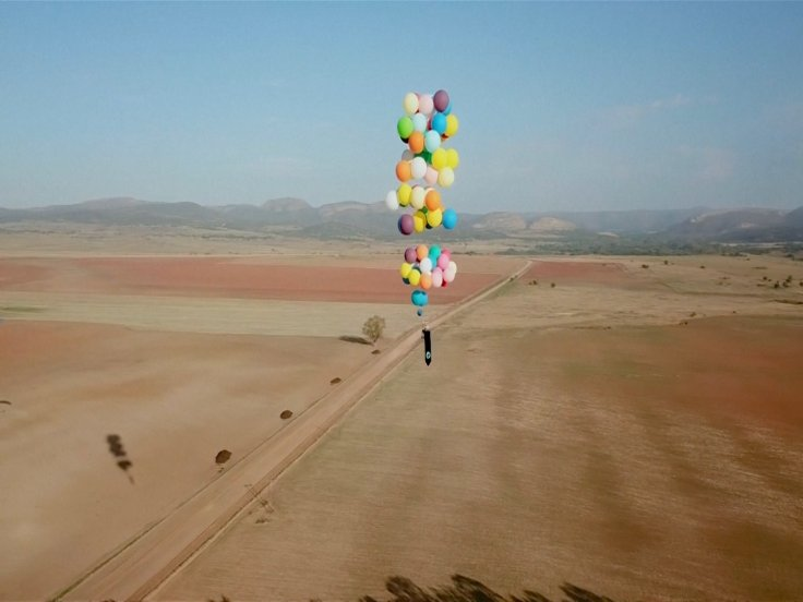 British Man Flies Over South Africa Using Only a Chair Tied to Helium Balloons