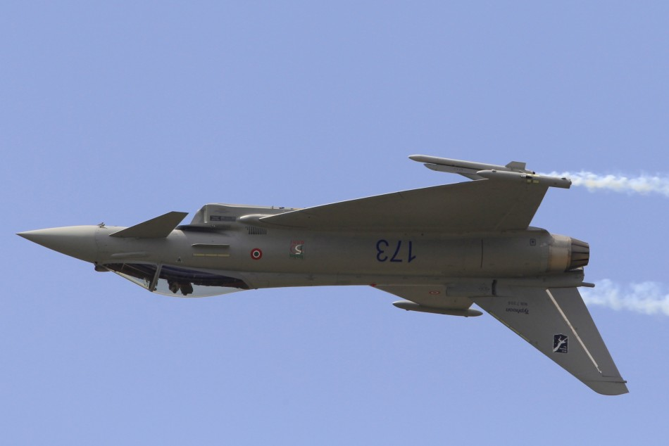 An Eurofighter Typhoon fighter jet takes part in a flying display during the 49th Paris Air Show at the Le Bourget airport
