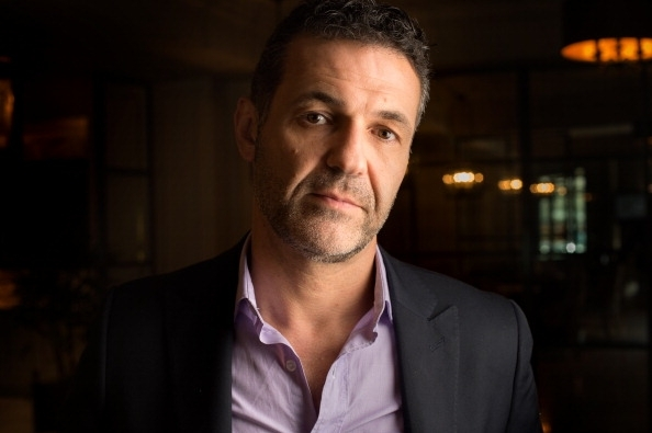 "Author Khaled Hosseini sits for an interview about his latest novel 'And the Mountains Echoed"" in Washington, D.C., on Thursday, May 23, 2013"