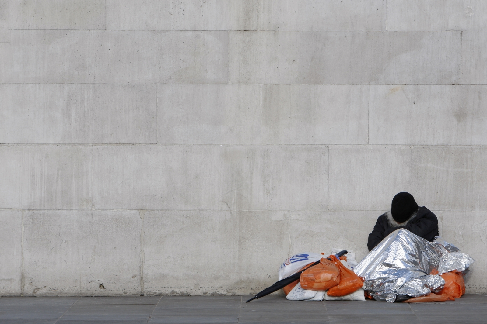 homeless person sleeps on street