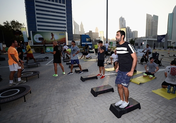People attend the Dubai Fitness Challenge at Dubai World Trade Centre on October 24, 2017 in Dubai, United Arab Emirates.The Mobile Fitness unit offers half-hour exercise classes every 45 minutes, in everything from yoga and boxercise to Zumba and pilates